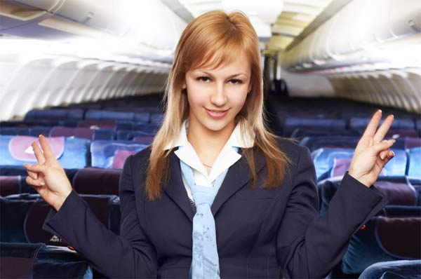 Flight attendant allowing people on board.